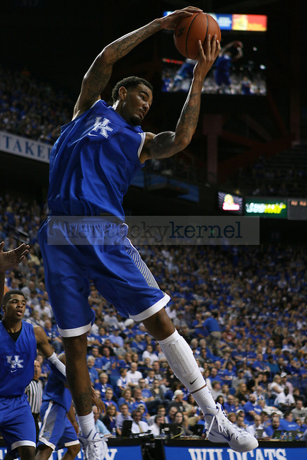 Forward Willie Caulie-Stein catches a rebound during the first half of the Blue-White Scrimmage at Rupp Arena on Monday, October 27, 2014 in Lexington, Ky. Photo by Adam Pennavaria | Staff