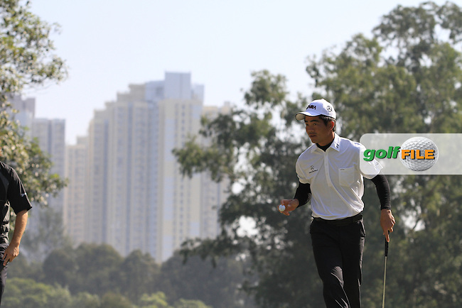 Liang Wen-chong (CHN) on the 3rd green on Day 3 of the UBS Hong Kong Open 2011..Photo GOLFFILE/Jenny Matthews.(Photo credit should read Jenny Matthews/GOLFFILE)..