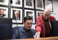 NWA Democrat-Gazette/CHARLIE KAIJO Gordon Fisher, running for Benton County constable, (center) fills out candidate filing paperwork as Duane Neal, (right) helps with the process, Monday, November 4, 2019 at the Benton County Administration Building in Bentonville.