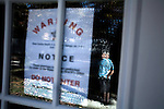 November 21, 2007. Fuquay Varina, NC.. As social security disability applications have reached an estimated 750,000 outstanding nation-wide many individuals have been waiting years to hear about their claims, as there conditions worsen and some have lost their homes to foreclosure and eviction.. Thomas Airington, 48, lost his home in the year since he filed for disability. Airington suffers from back pain due to a past surgery and nerve damage in his feet. He stands in front of his former home, that now sits empty as his family owns the adjoining land and will not give water to the new owner. The eviction notice is still on the door.