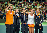 Moskou, Russia, Februari 7, 2016,  Fed Cup Russia-Netherlands, The Dutch team celebrate after defeating Russia 3-0, Ltr: Captain Paul Haarhuis, Richel Hogenkamp, Arantxa Rus ,Kiki Bertens and Cindy Burger<br /> Photo: Tennisimages/Henk Koster