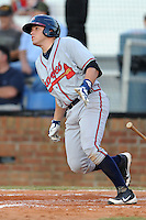 Danville Braves third baseman Victor Caratini #17 swings at a pitch during a game against the Johnson City Cardinals at Howard Johnson Field on June 23, 2013 in Johnson City, Tennessee. The Cardinals won the game 5-4. (Tony Farlow/Four Seam Images)