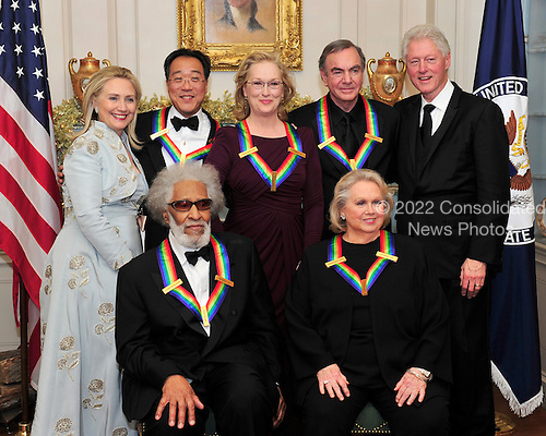 The five recipients of the 2011 Kennedy Center Honors pose for a photo with United States Secretary of State Hillary Rodham Clinton and former U.S. President Bill Clinton following a dinner hosted by Secretary Clinton at the U.S. Department of State in Washington, D.C. on Saturday, December 3, 2011. Back row, from left to right: Secretary Clinton; musician Yo-Yo Ma; actress Meryl Streep; singer Neil Diamond; and President Clinton. Front row, from left to right: musician Sonny Rollins; and actress Barbara Cook..Credit: Ron Sachs / CNP