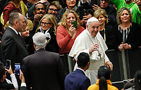 Pope Francis greets the faithful as he arrives to attend his weekly general audience in the Paul VI hall at the Vatican, January 22, 2020.<br />