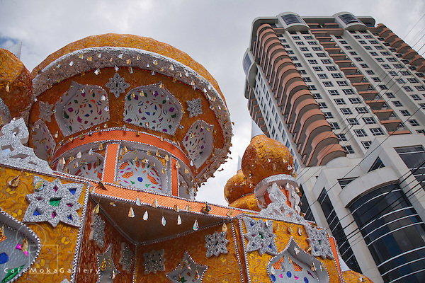 Moslem festival of Hosay, High rise building contrating with the decorative tadjah