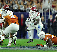 NWA Media/Michael Woods --12/29/2014-- w @NWAMICHAELW...University of Arkansas running back Alex Collins finds a hole in the Texas defense as he runs the ball in the 1st quarter of the Texas Bowl Monday night at  NRG Stadium in Houston.