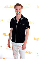 LOS ANGELES - JUL 27:  Calum Worthy at the 3rd Annual MBJAM19 at the Dave & Busters on July 27, 2019 in Los Angeles, CA
