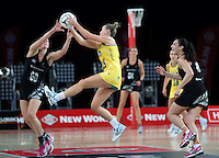 19.09.2013 Silver Ferns Casey Kopua and Australian Diamonds Kim Green in action during the Silver Ferns V Australian Diamonds New World Netball Series played at Vector Arena in Auckland. Mandatory Photo Credit ©Michael Bradley.