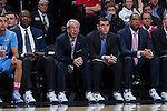 (L-R) North Carolina Tar Heels coaches Steve Robinson, head coach Roy Williams, C.B. McGrath and Hubert Davis watch from the sideline during first half action against the Wake Forest Demon Deacons at the LJVM Coliseum on January 21, 2015 in Winston-Salem, North Carolina.  The Tar Heels defeated the Demon Deacons 87-71.  (Brian Westerholt/Sports On Film)