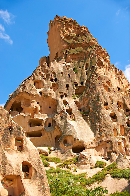 Troglodyte cave houses in tuff volcanic rock, Cappadocia at Uchisar, Anatolia, Turkey