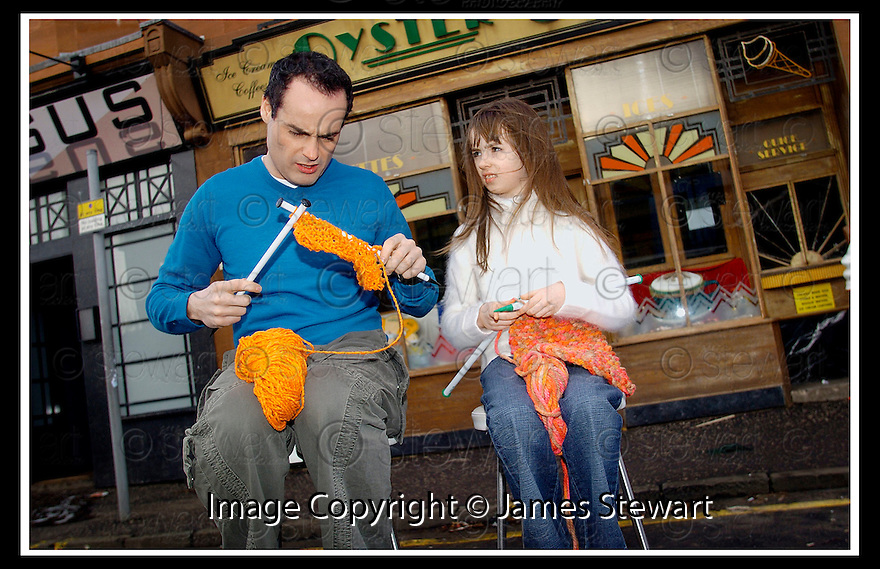 01/01/2006         Copyright Pic: James Stewart.File Name : sct_jspa03 river city knitting.RIVER CITY STAR KIERAN ELLIOTT GETS KNITTING LESSONS FROM HIS ON SCREEN DAUGHTER, PLAYED BY 9 YEAR OLD NATASHA WATSON.... THEY ARE PICTURED ON SET OUTSIDE THE OYSTER CAFE DURING A BREAK IN FILMING....(see copy from George Mair / Tim Bugler)....Payments to :.James Stewart Photo Agency 19 Carronlea Drive, Falkirk. FK2 8DN      Vat Reg No. 607 6932 25.Office     : +44 (0)1324 570906     .Mobile   : +44 (0)7721 416997.Fax         : +44 (0)1324 570906.E-mail  :  jim@jspa.co.uk.If you require further information then contact Jim Stewart on any of the numbers above.........