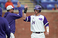 Conner Dunbar (24) of the High Point Panthers high fives a teammate after scoring a run in the bottom of the first inning against the Campbell Camels at Williard Stadium on March 16, 2019 in  Winston-Salem, North Carolina. The Camels defeated the Panthers 13-8. (Brian Westerholt/Four Seam Images)