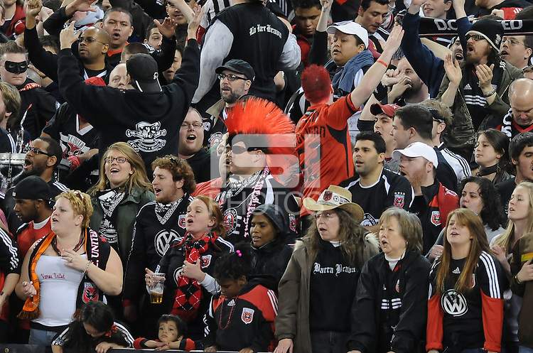 DC United fans supporting the team.   DC United defeated The Columbus Crew  3-1 at the home season opener, at RFK Stadium, Saturday March 19, 2011.