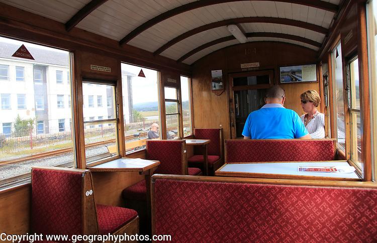 Passengers inside train carriage of Ffestiniog railway, Gwynedd, north west Wales, UK