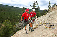 Photo story of Philmont Scout Ranch in Cimarron, New Mexico, taken during a Boy Scout Troop backpack trip in the summer of 2013. Photo is part of a comprehensive picture package which shows in-depth photography of a BSA Ventures crew on a trek.  In this photo a BSA Venture Crew members gets some rock climbing instruction before rappelling down the side of a natural surface rock at Cimarroncito Camp in the backcountry at Philmont Scout Ranch.   <br /> <br /> <br /> The  Photo by travel photograph: PatrickschneiderPhoto.com