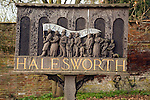 Carved wooden sign showing history of Halesworth, Suffolk, England