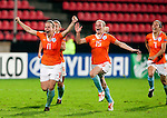 Sylvia Smit, Claudia van den Heiligenberg and Annemieke Kiesel-Griffioen celebrate the  penalty shot win, QF, Holland-France, Women's EURO 2009 in Finland, 09032009, Tampere, Ratina Stadium.