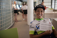 Johan Esteban Chaves (COL/Orica-GreenEDGE) holding his 'tag-card' up (and finding it funny) ahead of the Grande Partenza in Apeldoorn (NLD): team presentation of the 99th Giro d'Italia 2016 on the evening before the 1st stage