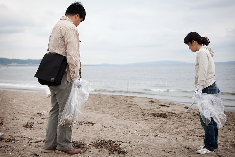 Tokyo -  May 29, 2010 - Konkatsu, the Japanese marriage Hunting. On Miura beach, 80 km from Tokyo, a konkatsu tour is organized for the participants who want to collect garbage on the beach.