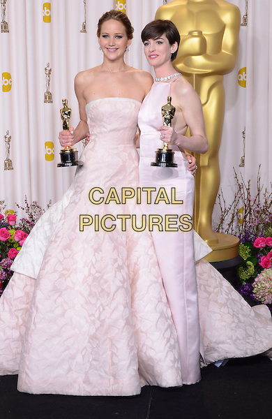 Jennifer Lawrence, Anne Hathaway.85th Annual Academy Awards held at the Dolby Theatre at Hollywood & Highland Center, Hollywood, California, USA..February 24th, 2013.pressroom oscars full length white award trophy trophies winner winners white pink pale strapless dress trophies winners .CAP/ADM/RE.©Russ Elliot/AdMedia/Capital Pictures.