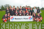 CHAMPIONS: Cian kennedy capt Dynamos youth team accepting the Jimmy Falvey Memorial Cup from Brendan Falvey after they defeated Killarney Athletic in the Jimmy Falvey Memorial Youth Cup final 5-0 at Mounthawk Park, Tralee on Sunday.