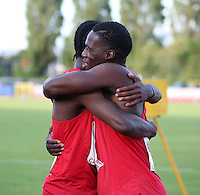 Tuesday 15th July 2014<br /> Pictured: Christian Malcolm<br /> RE: Welsh sprinter Christian Malcolm, embraces his team mate after running his last race on home soil at the Welsh Athletics International in the Cardiff International Sports Stadium, South Wales, UK.