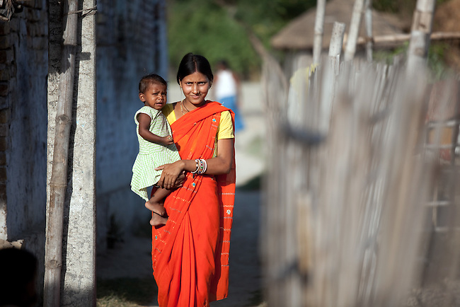 Priyanka Devi with her daghter Kriti Kumari on her way to the local Anganwadi health clinic for oral rehydration salts (ORS) and zinc tablets to combat her daughters potentially fatal diarrhea in her home village of Vaishali.The village located in Vaishali district outside Patna in Bihar, India has been rolling out the ORS and Zinc program as part of the IKEA Social Initiative to combat child mortality rates caused by diarrhea. It is proving to be very successful with education and support provided by local nursing staff, health activists  and program officers from UNICEF. The treatment is a 14 day course administering diluted oral rehydration salts and a zinc tablet which is more effective than salts alone in combating the effects of severe diarrhea. Picture by Graham Crouch/UNICEF