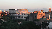 Colosseum or Flavian Amphitheatre (left), c70-82 AD, Basilica di Santa Francesca Romana (right), 10th century, Rome, Italy. Picture by Manuel Cohen