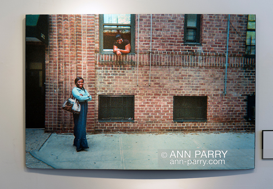 Huntington, New York, USA. August 1, 2015. Huntington, New York, USA. August 1, 2015. Photo by Jane Mary Saiter of two of her neighbors at tenement building is on display at Reception for Project Lives exhibition at fotofoto gallery in Long Island. Over 200 residents throughout 15 New York Public Housing projects were given single use film cameras to photograph what's important to them in their world. The photography project was originated by G. Carrano and the book Project Lives was edited by Carrano, C. Davis and J. Fisher, with all royalties from its sale to be donated to resident programs at NYC Housing Authority.