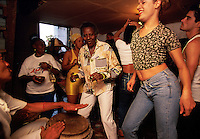 Alexander dances at a santeria held at her sister's house. Santeria is an amalgam of Catholic and Yoruba beliefs that Afro-Cuban slaves brought with them. Unlike Catholic saints, the deities or oreshas have human frailties. Concepts of original sin and final judgment are unknown and ancestral worship is practiced. Alexander is comfortable with her life as a transvestite, although gays have had difficult times in Cuba. In the 60s, they were arrested and reprogrammed. But in recent times are more relaxed attitude has emerged. Alexander was issued a government identification card as a woman.