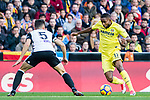 Cedric Bakambu of Villarreal CF (R) fights for the ball with Gabriel Armando De Abreu of Valencia CF (L) during the La Liga 2017-18 match between Valencia CF and Villarreal CF at Estadio de Mestalla on 23 December 2017 in Valencia, Spain. Photo by Maria Jose Segovia Carmona / Power Sport Images