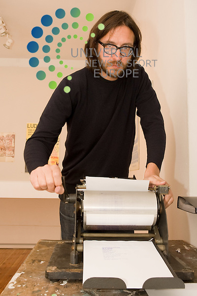Exhibition curator Rob Tufnell prints off material for the Writing on Your Wall exhibition at Edinburgh Printmakers, 23 Union Street Edinburgh 17 Sept - 29 Oct 2011 Picture: Jon Davey Universal News And Sport (Europe) 16 Sept 2011. All pictures must be credited to www.unpixs.com. (Office) 0844 884 51 22.