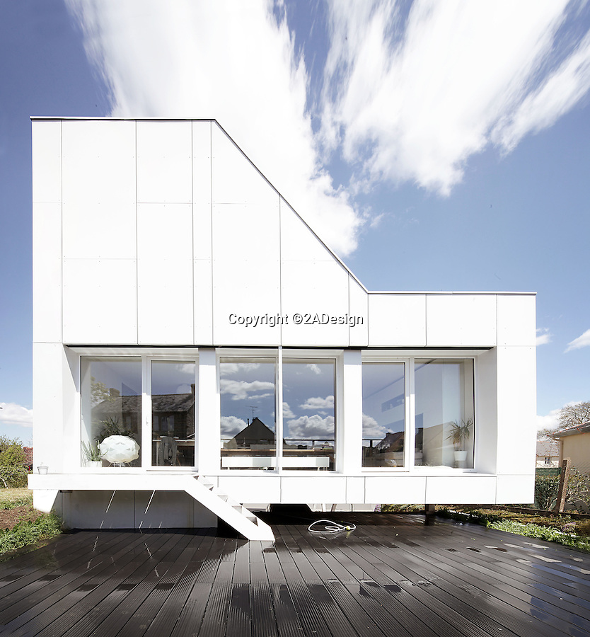 BNPS.co.uk (01202 558833)<br /> Pic: 2ADesign/BNPS<br /> <br /> Ultra-modern family home built for just £125,000.<br /> <br /> An architect has constructed an super cool family home out of shipping containers for the cost of a bedsit flat.<br /> <br /> The 'Flying Box' house is the creation of  Josué Gillet who built the family home as a result of his limited space and budget and lives there with his wife and young son. <br /> <br /> The revolutionary structure near Rennes in north west France uniquely incorporates five 'high cube' shipping containers - an extra-large variant of the transportation device that measures 40ft long.