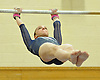 Miranda Lund of Plainview JFK performs on the uneven bars during a Nassau County varsity gymnastics meet against Massapequa at McKenna Elementary School on Monday, Feb. 1, 2016. She scored a 9.25 in the event and posted an all-around high of 36.6 to lead Plainview JFK to a 164.7-163.6 win.