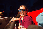 A girl wears 3D glasses in the Despicable Me Minion Mayhem ride at Universal Studios Hollywood in Los Angeles, CA