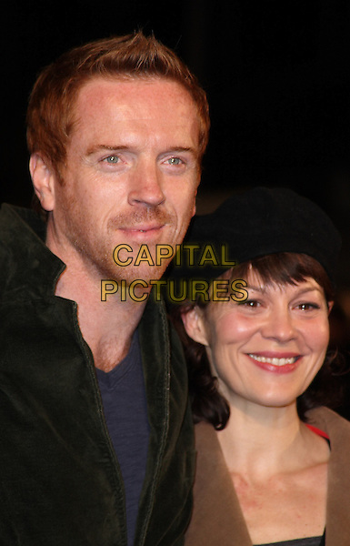 "DAMIAN LEWIS & HELEN McCORY .2009 London Film Festival - Times Gala and the UK Premiere of ""The Men Who Stare At Goats"" at the Odeon, Leicester Square, London, England, UK,.October 15th 2009.portrait headshot damien married couple husband wife beret black hat green jacker smiling stubble facial hair .CAP/ROS.©Steve Ross/Capital Pictures.CAP/JIL.©Jill Mayhew/Capital Pictures"