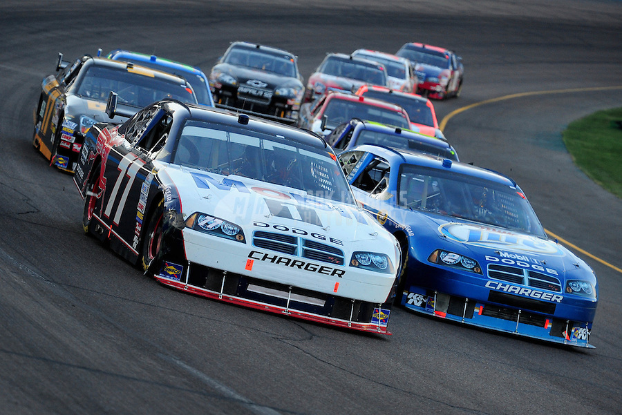Apr 12, 2008; Avondale, AZ, USA; NASCAR Sprint Cup Series driver Sam Hornish Jr (77) races alongside teammate Kurt Busch (2) during the Subway Fresh Fit 500 at Phoenix International Raceway. Mandatory Credit: Mark J. Rebilas-