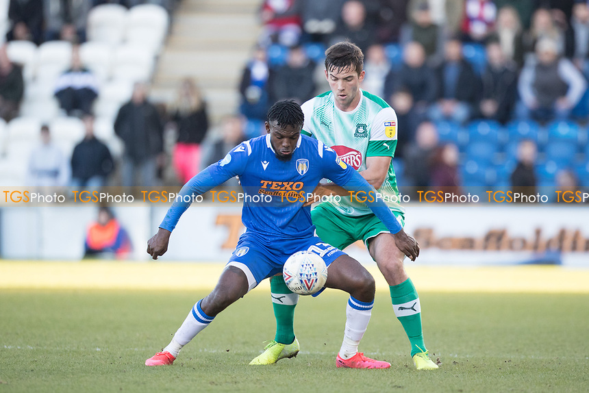 Theo Robinson of Colchester United holds off Niall Canavan of Plymouth Argyle during Colchester United vs Plymouth Argyle, Sky Bet EFL League 2 Football at the JobServe Community Stadium on 8th February 2020