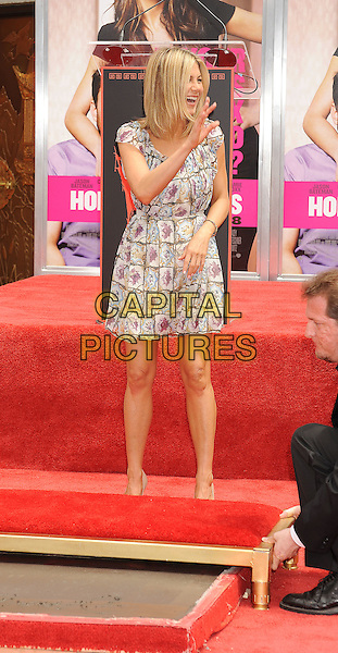 Jennifer Aniston.The Jennifer Aniston Hand and Footprints Ceremony held at The Grauman's Chinese Theatre in Hollywood, California, USA..July 7th, 2011.full length white grey gray purple floral print dress beige peep toe shoes smiling hand waving .CAP/ROT/TM.©Tony Michaels/Roth Stock/Capital Pictures