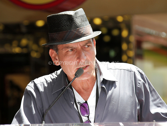 WWW.ACEPIXS.COM . . . . .  ..... . . . . US SALES ONLY . . . . .....July 10 2012, LA....Charlie Sheen celebrates Slash's star on the Hollywood Walk of Fame on July 10, 2012 in Hollywood, California.....Please byline: FAMOUS-ACE PICTURES... . . . .  ....Ace Pictures, Inc:  ..Tel: (212) 243-8787..e-mail: info@acepixs.com..web: http://www.acepixs.com