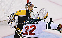 (11/06/2017- Boston, MA) Boston Bruins goalie Tuukka Rask makes a third period save as Minnesota Wild right wing Nino Niederreiter closes in on him at TD Garden on Monday, November 6, 2017. Staff Photo by Matt West