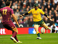 Twickenham, England. Berrick Barnes of Australia drop kick goal during the QBE international match between England and Australia for the Cook Cup at Twickenham Stadium on November 10, 2012 in Twickenham, England