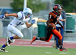 SIOUX FALLS, SD - SEPTEMBER 19: Rasheed Benton #7 from Washington gets a step around the corner past Luke Bates #10 from Rapid City Stevens en route to a 91 yard touchdown run in the second quarter of their game Friday night at Howard Wood Field.  (Photo by Dave Eggen/Inertia)