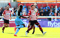 Will Hoskins of Exeter City on the ball under pressure from Marcus Bean of Wycombe Wanderers during the Sky Bet League 2 match between Exeter City and Wycombe Wanderers at St James' Park, Exeter, England on 26 September 2015. Photo by Pinnacle Photo Agency.