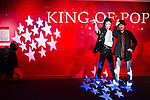Oct. 4, 2011 - Tokyo, Japan - A Japanese visitor poses with the wax figure of Michael Jackson at the Madame Tussauds museum exhibit. The world's 13th Madame Tussauds museum showcases 19 wax figures of  celebrity musicians and movie stars. (Photo by Christopher Jue/AFLO)