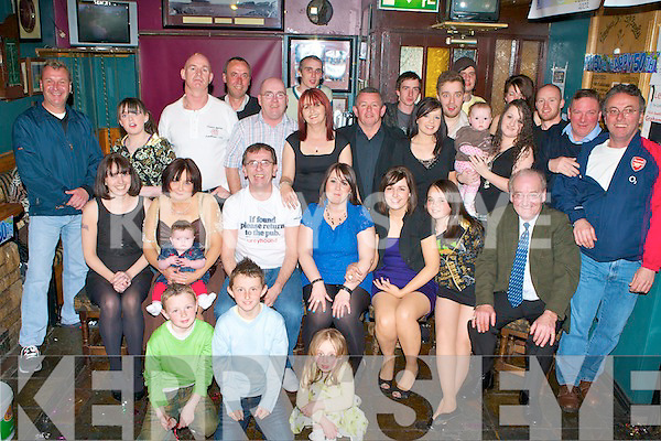 BIG SURPRISE: Peter Donoghue, Shanakill, Tralee (seated 3rd left) got a big surprise when family and friends gathered to celebrated his 50th birthday at the Greyhound bar Tralee on Sunday.