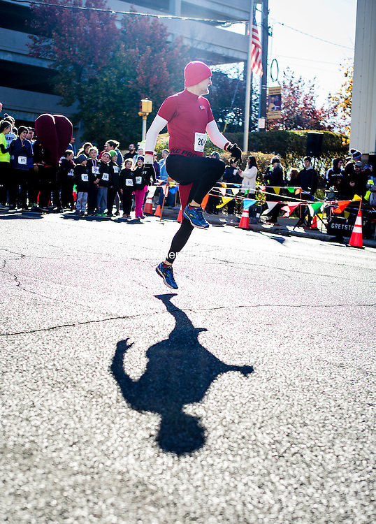 Waterbury, CT- 12 November 2016-111216CM02- Tim Beach of Prospect warms up before the start of a Veteran's Day 5K road race in downtown Waterbury on Saturday.  The event put on by Sacred Heart High School benefited the Sacred Heart High School Scholarship Assistance Program and the Wounded Warriors Project.  Approximately 250 participants entered the race said Mike Madden, one of the event organizers and Assistant Director of Athletics at the school.    Christopher Massa Republican-American