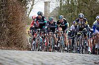 Sir Bradley Wiggins (GBR/Sky) leading the peloton, and teammate Ian Stannard (GBR/Sky), over the Kruisberg cobbles.<br /> <br /> Omloop Het Nieuwsblad 2015