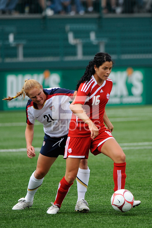 Jonelle Filigno (16) of Canada (CAN) plays the ball marked by Rachel Buehler (21) of the United States (USA). The United States (USA) Women's National Team defeated Canada (CAN) 1-0 during an international friendly at Marina Auto Stadium in Rochester, NY, on July 19, 2009.