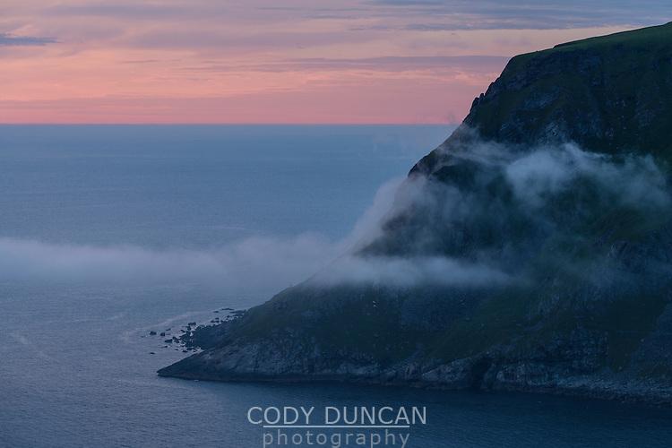 Sea fog forms over headlands at Kleivnes, Vestvågøy, Lofoten Islands, Norway